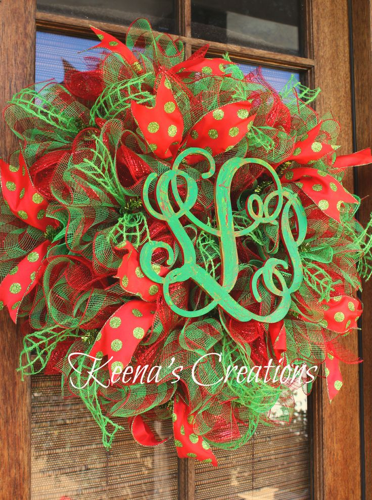 Gorgeous ruffle deco mesh Christmas wreath in red, lime and red/lime plaid; red/lime polka dot ribbon; lime window pane jute ribbon. The centerpiece is a 3-letter Vine monogram crackled and distressed in red and lime.   http://www.facebook.com/keenascreations