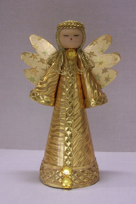 Traditional style gold angel for a christmas tree topper for Angel christmas tree decoration