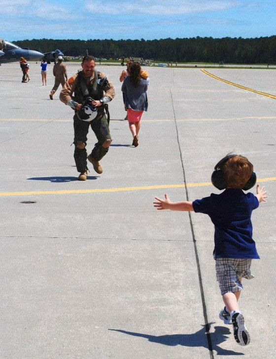 """My brother-in-law, Major Brian Davis, Harrier pilot, VMA-223 (Cherry Point, NC) returned from a nine month deployment in Afghanistan to his son, Cooper running with his arms outstretched to greet his dad. Brian returned just in time for the birth of his second son, Greyson.""    -Tyler Stone"