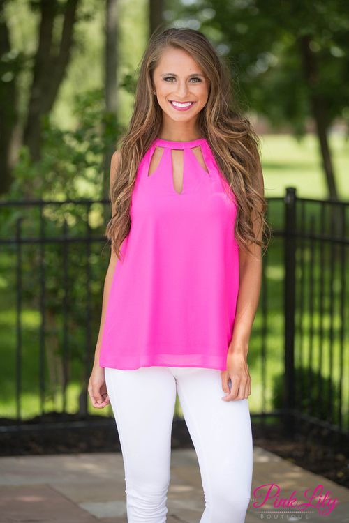 We've got your new go-to blouse for Girls Night Out! The bold hot pink color on this sleeveless blouse is perfect for warm summer nights, while we adore the cutouts on the bodice and the halter neck style! There's also a keyhole cutout in back and two cute buttons in back.
