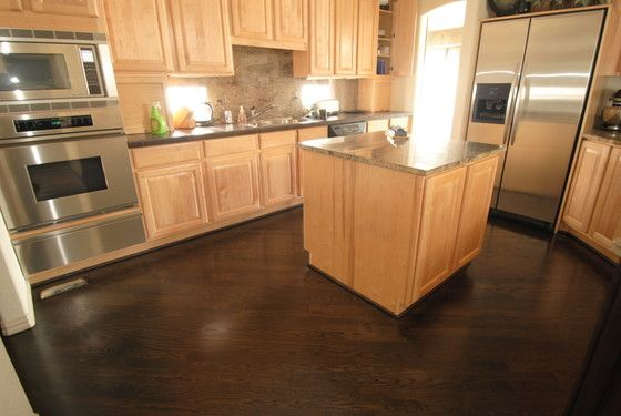 Honey colored cabinets with dark wood oak floor dark for Wood floors in kitchen