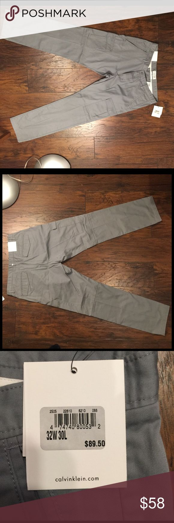 NWT Calvin Klein Men's Body Slim Fit Cargo Pants Beautiful Calvin Klein Grey Cargo pants. Brand new never worn. Part of the 2015 S/S collection. Measures 32W 30L. Retail is $89.50. Make me an Offer! Calvin Klein Pants Cargo