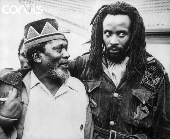 "Prime Minister Jomo Kenyatta (former leader of Mau Mau rebellion) w/ ""Field Marshal"" Mwariama"