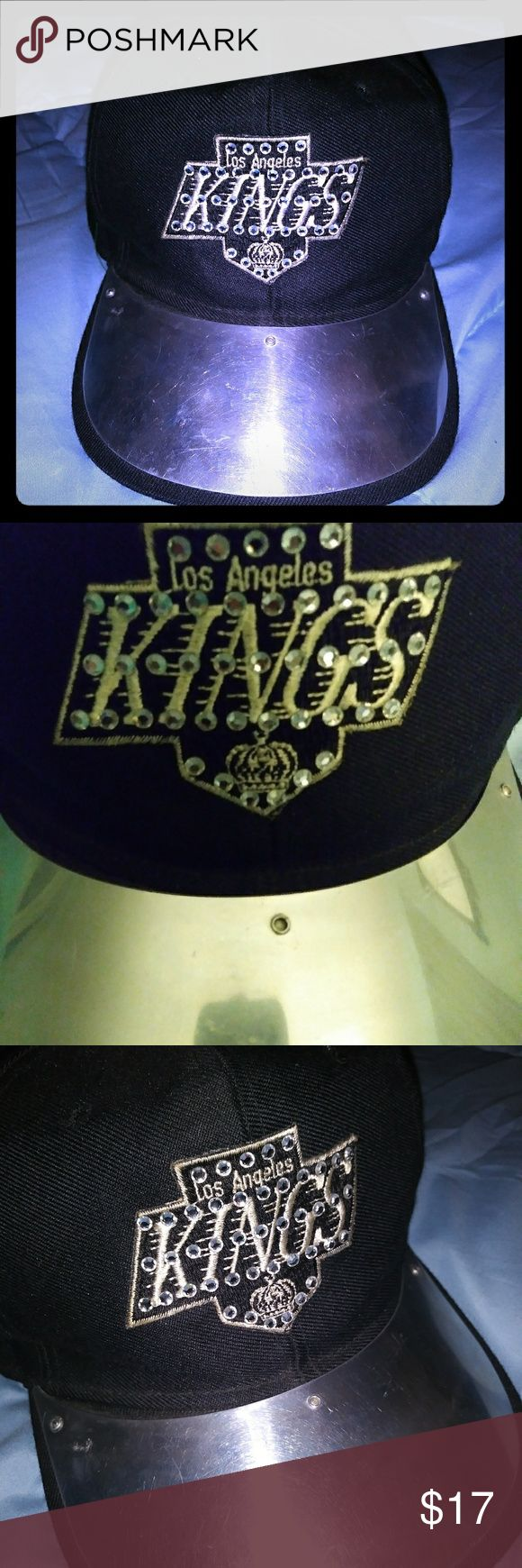 90's Metal Rim LA Kings Cap Rare Vintage 90's LA Kings baseball Cap, Metal Rim & Rhinestone Bedazzled. You can't find these in the stores anymore. Good used condition, a few stitches popped on the side, see pic 4 Accessories Hats