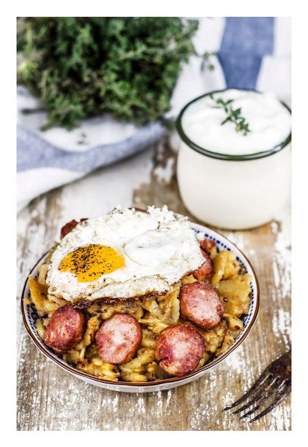 Fried potatoes with sausage, onion and eggs