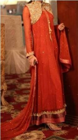 Latest Fashion in Pakistan with embroidery work on top.