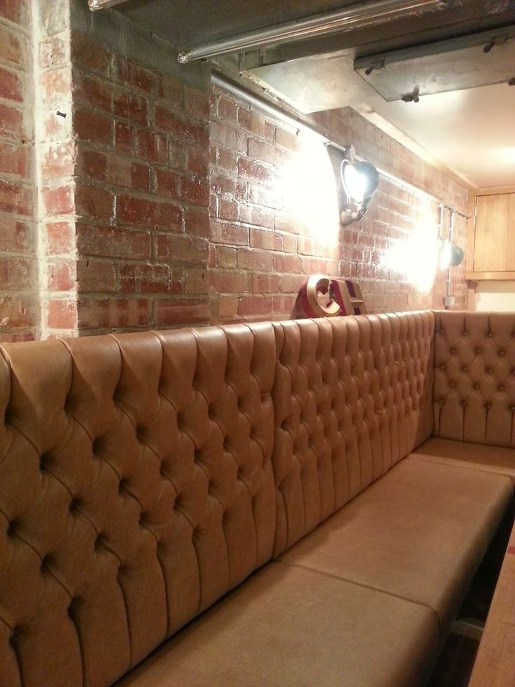 Exposed Brickwork Tan Leather Banquette Seating