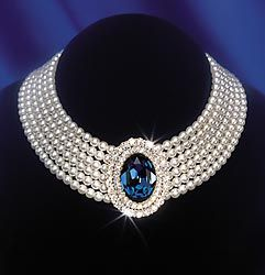 Diana's seven strand pearl choker with a lush sapphire in the centre