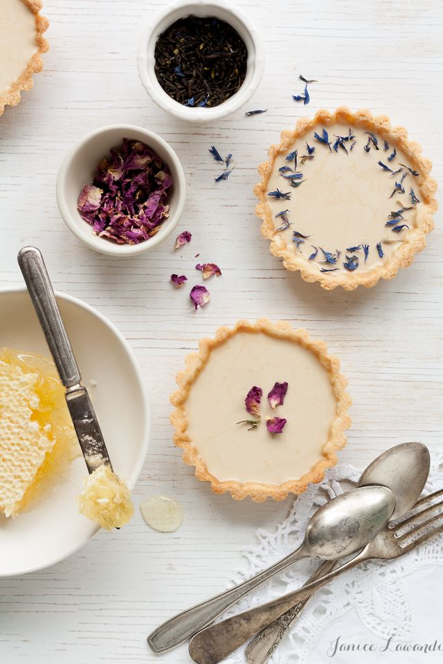 earl grey panna cotta tarts with dried flowers.