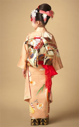 Kimono little girl. Back style. Pattern of this kimono is a traditional toy of Japan.