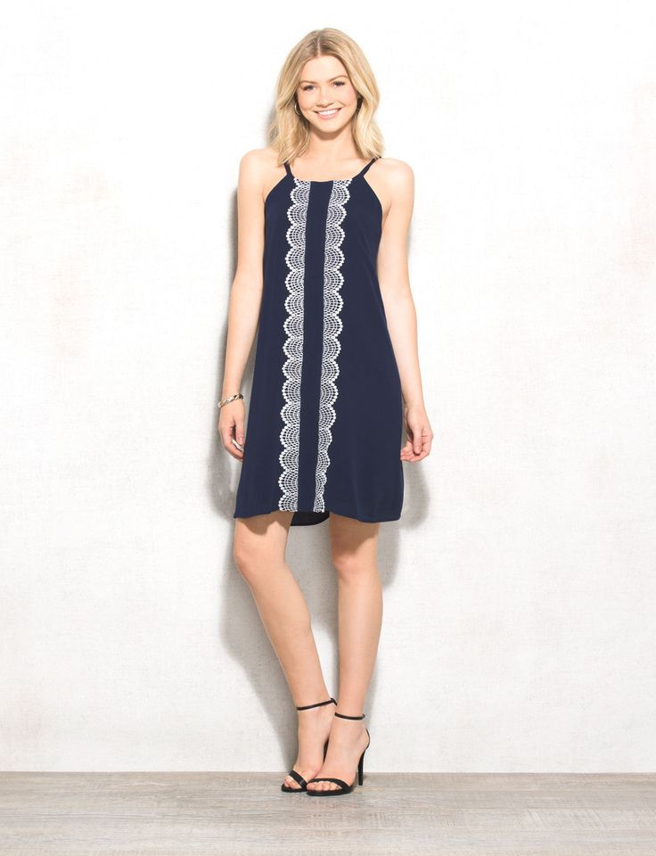 A hint of crochet goes a long way! Take on the weekend in chic style with this textured navy dress. Pair it with neutral sandals during the day and throw on a denim jacket at night. Imported.