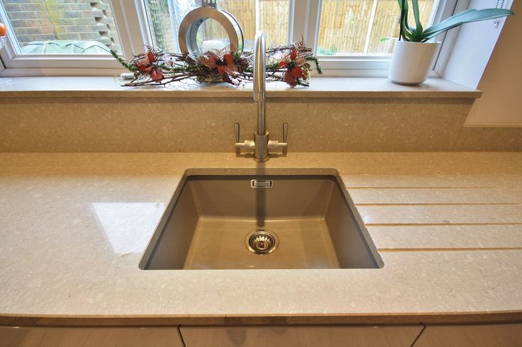 Under-mounted resin sink, strong hard wearing and durable material matching the worktop as best as possible.