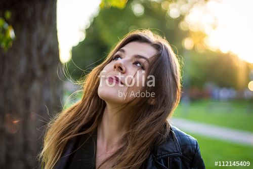Joyful Young Woman Smiling To The Sun