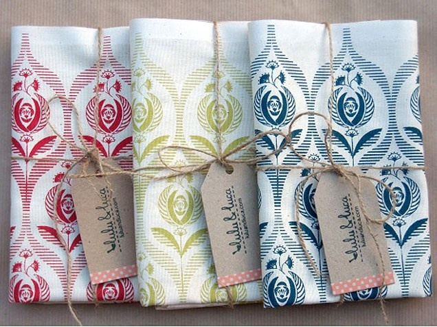 Tea Towels ~ Tea Towels: These Art Deco-inspired rose print tea towels come in three colors and are an inexpensive way to brighten up a kitchen. (At $39, I wouldn't call them inexpensive!! I'd probably never use them - put them on display only! LOL)