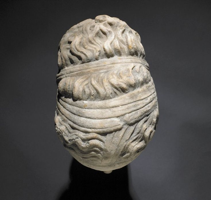Marble portrait head of woman wearing band across forehead and opisthosphendone, possibly Sappho; nose restored.