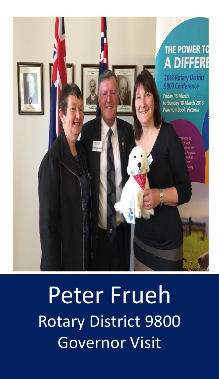 DG Peter and  wife Anne with Pres. Katrina. Note the Maremma dog. 'As a lead up to the District Conference in Warrnambool in March, he told us how a local chicken farmer, Swampy Marsh, suggested Maremma guardian dogs could be used to protect the endangered penguins on an island just off Warrnambool. Swampy had successfully used Maremmas to help protect his free range chickens. The penguins are now thriving'.