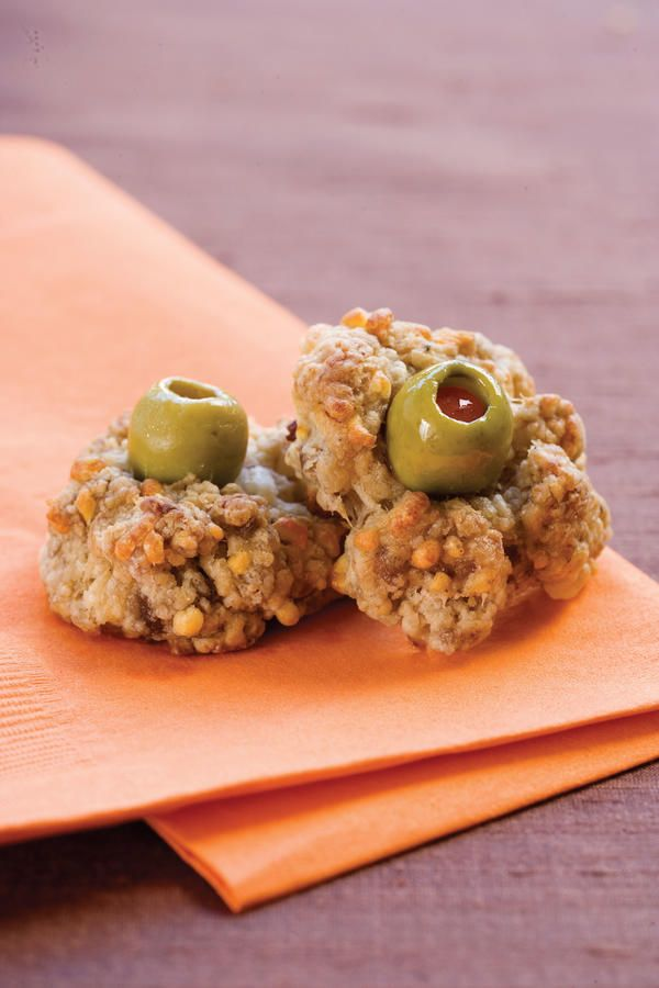 Monster Eyes - Halloween Party Appetizers and Finger Food - Southernliving. Recipe: Monster Eyes  There will be a look of hunger rather than fear in everyone's eyes when they first get a glimpse of this deliciously devilish Halloween party treat. In this recipe, we switch from traditional Cheddar cheese to Muenster cheese—you can call it Monster cheese—to give a new taste to traditional sausage balls. To make these amazing Monster Eyes seem even more frightening, Spanish olives complete the…