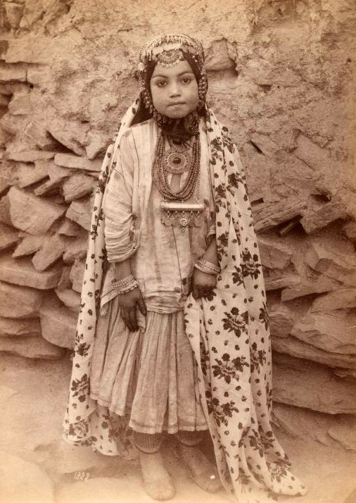 Iran  | Young girl adorned with silver jewellery.  Tehran | ca. Late 19th to early 20th century | Qajar Dynasty | Photo by Antoin Sevruguin