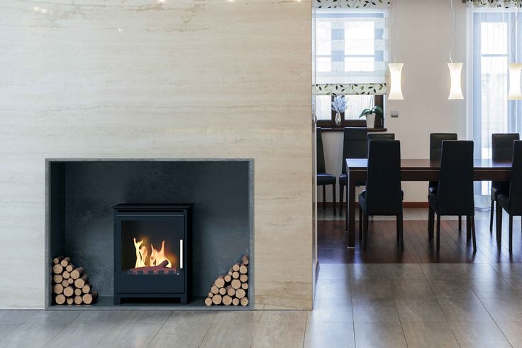 The new Bredon fireplace has the style of a traditional woodburner but with the simplicity of a bioethanol fireplace. No smoke. No chimney needed.  It takes only bioethanol fuel; the logs flanking the fireplace are for illustration only.