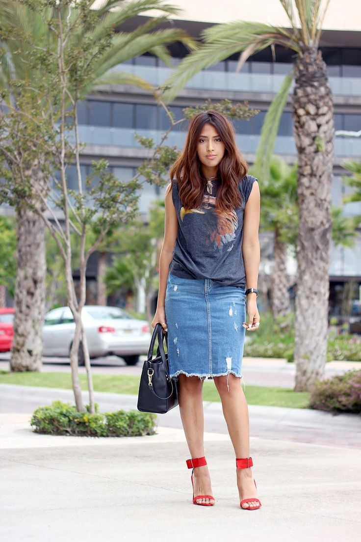 20 Modern Ways to Style a Denim Skirt for Spring - distressed + raw hem denim skirt worn with a cut-off graphic t-shirt + sexy red ankle strap heels