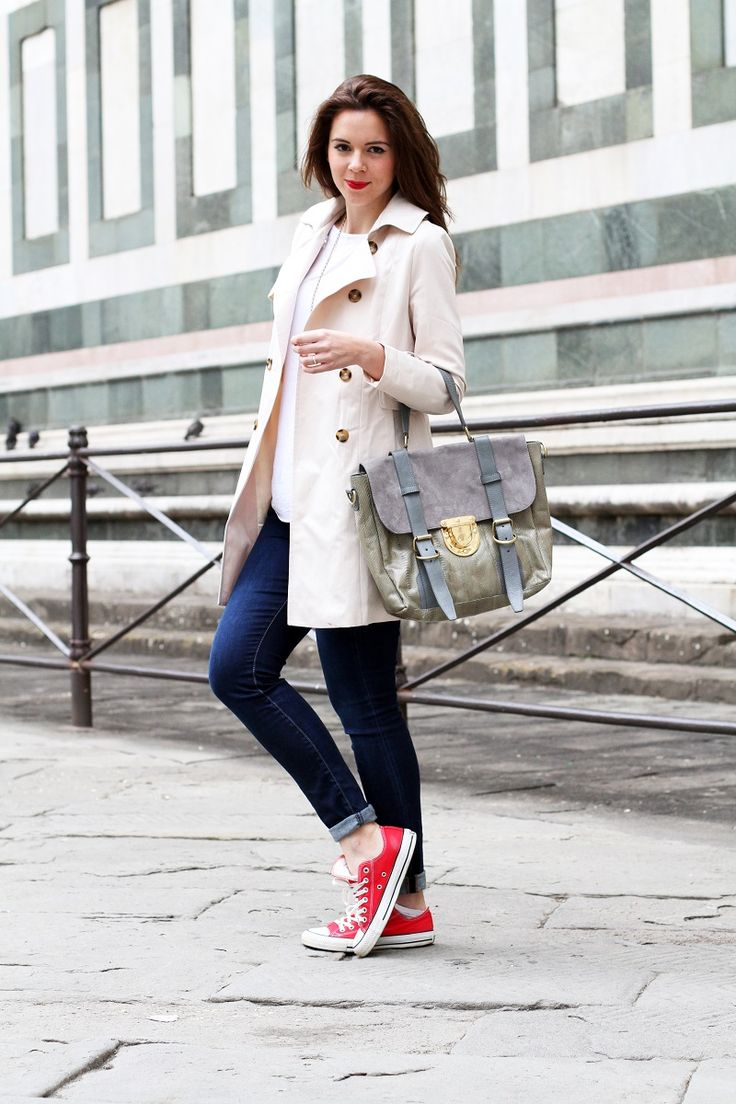 trench and red converse