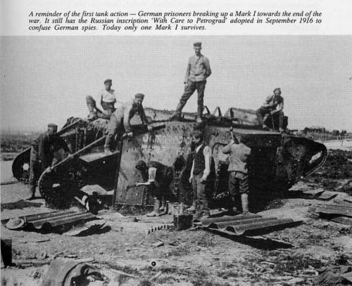 """WWI; A Reminder of the first tank action- German prisoners breaking up a Mark I towards the end of the war. It still has the Russian inscription """" With Care to Petrograd"""" adopted in September 1916 to confuse German spies. Today only one Mark I survives."""""""