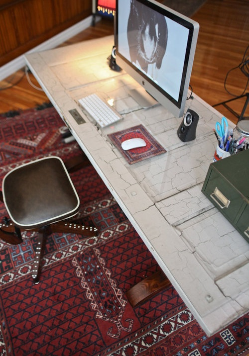 weathered recycled door as a desk top~DIY...i like this idea except i would have to put plexiglass on it to make it smooth