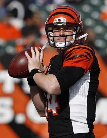 The Cincinnati Bengals quarterback Andy Dalton (14) gets ready to take on the Denver Broncos prior to their game at Paul Brown Stadium.