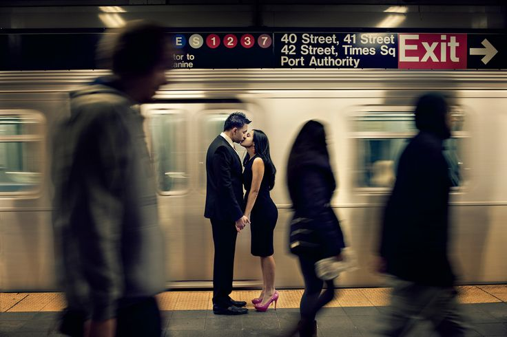 Engagement session in NYC subway station. Photo by Maloman Studios