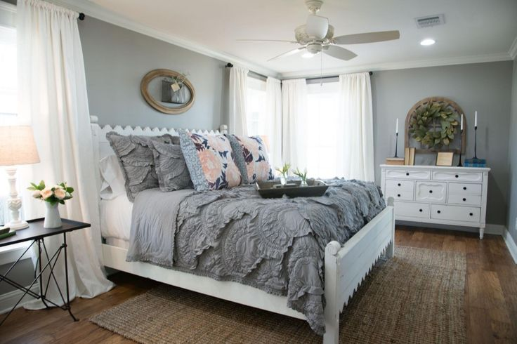 The master bedroom and was right off the kitchen, so I wanted to set it apart by using this mid-tone gray paint color. I was inspired by the simplicity of this space and hoped it would be a quiet retreat for Rob and Marianne.