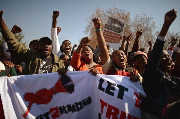 Young people participate in a march to commemorate Youth Day in Soweto Township on June 16 2013 in Johannesburg South Africa Youth Day commemorates...