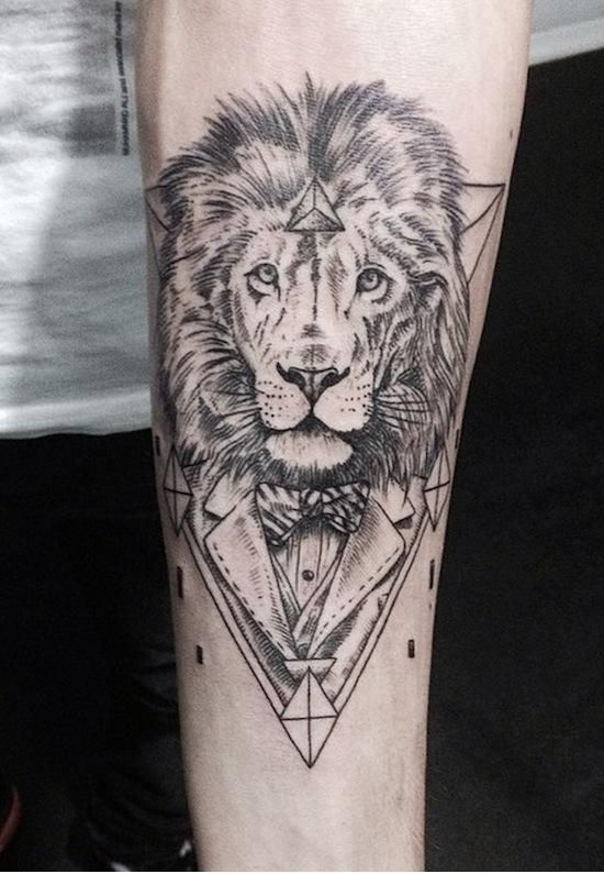 Lion in a suit tattoo by Emrah Özhan | Tattoomagz.com