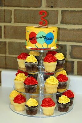 Curious George cupcake tower and cake