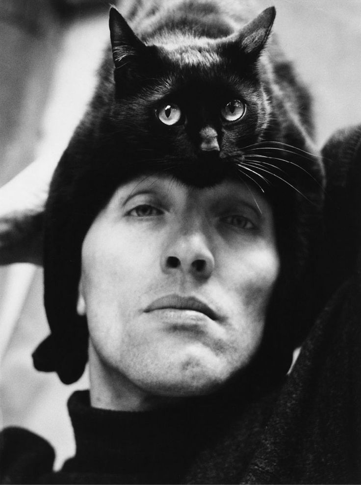 "(German photographer Herbert Tobias and his cat, Tobias.) * * TOBIAS: "" HE PUTS MEEZ HERES. ME THINKS DE SAUERKRAUT HE ATES FER LUNCH WENTS TO HIZ BRAIN."""