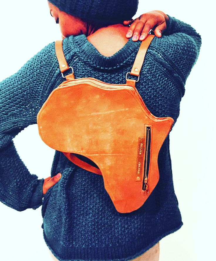 Our signature Africa shape leather satchel/backpack is the 1st and one of a kind vintage style 100% cowhide leather bag crafted in the distinct shape of Africa, detailed with our orijin culture brand