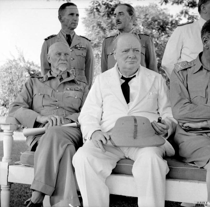 Winston Churchill with Field Marshal Smuts and behind, Sir Arthur Tedder (left)…