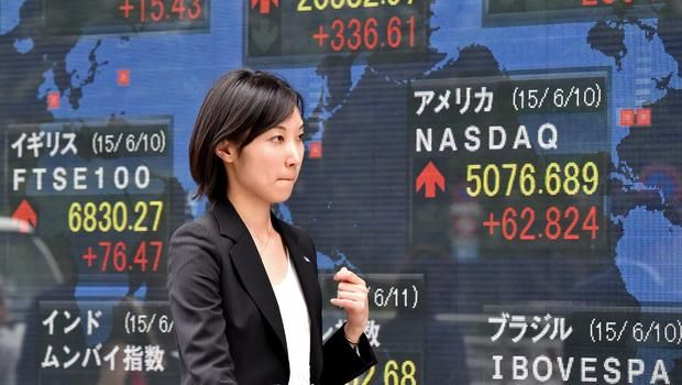 cac  40 share price - june 2015 | pedestrian passes before a share prices board in Tokyo on June 11 ...