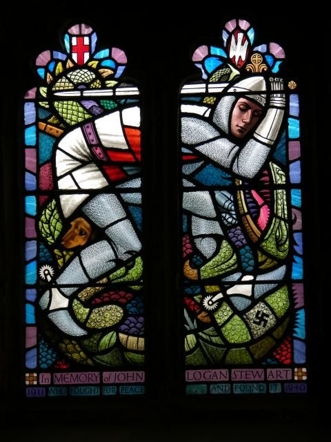 St George Fighting the Dragon, 1965, a stained-glass window by John Pettes in the Church of St Mary, Llandovery, Carmarthenshire, Wales; 'Memorial to Captain John Logan Stewart of Llanfair House, killed at Dunkirk 1940...The swastika on the dragon's limb symbolizes the evil which was defeated in World War II'. (Stained Glass in Wales)