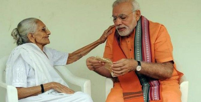 PM Modi meets mother on birthday, gets Rs.5001 as gift