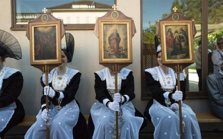 Women in traditional costumes take part in the eucharistic celebration on the occasion of the Feast of Corpus Christi in Appenzell, Switzerland