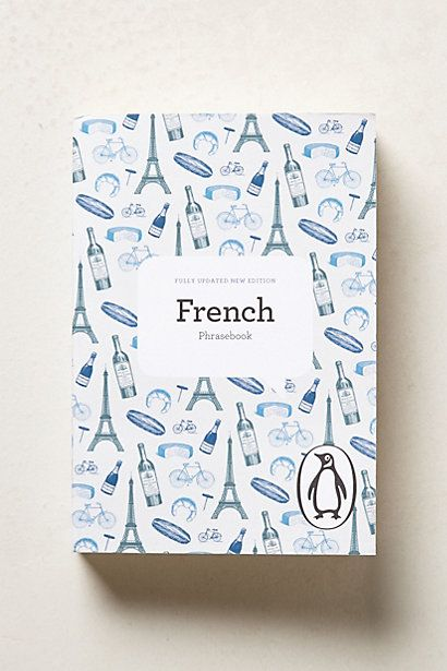Accessorizing for a Paris themed nursery with the Blue, Green, Black, Silver, Cream wallpaper color scheme