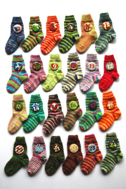 Cute sock advent calendar idea - you could string these up or mount them in the shape of a tree.  Try using old or mismatched socks from the thrift store!