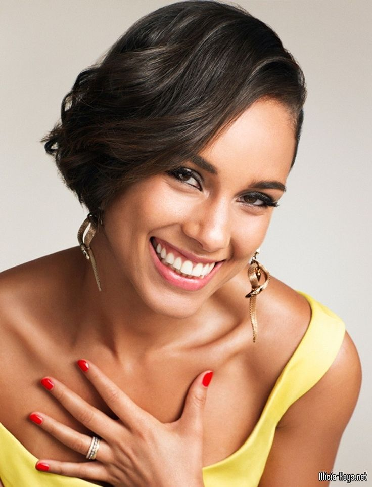 Alicia Keys  I'd put her smile right up there with Stana Katic & Billie Piper.  Gorgeous!
