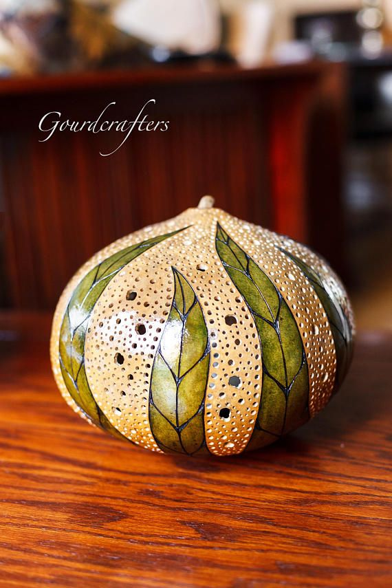 Flow II Gourdlamp Made from a large Malwi cannonball gourd. It is pyroengraved, hand dyed and drilled to create the lovely patterns on the gourd and the light effects it casts on the surrounding area. Each lamp is fully outfitted and wired. Please specify if intending for use in UK