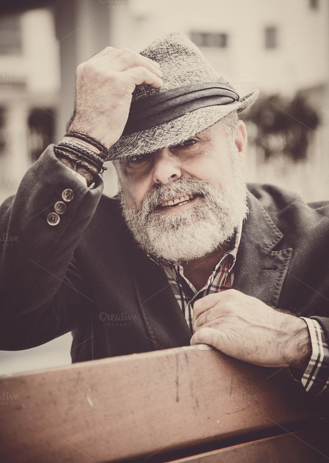 Check out Attractive old man with beard and ha by huertas19 on Creative Market