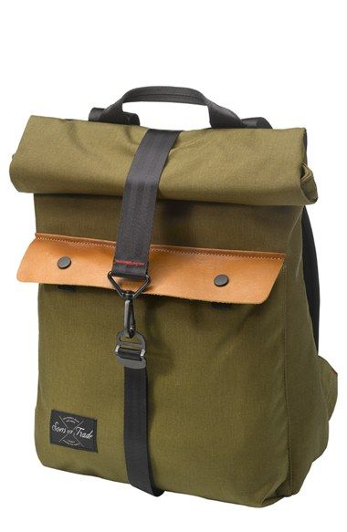 Free shipping and returns on Sons of Trade 'Pioneer' Backpack at Nordstrom.com. A slim-profiled roll-top backpack crafted from durable cotton canvas with leather flap-pocket accents reenvisions a vintage outdoors rucksack for the modern era. The deep main compartment is fully lined with a custom print and features a reinforced bottom and padded shoulder straps to help with heavy-duty loads.