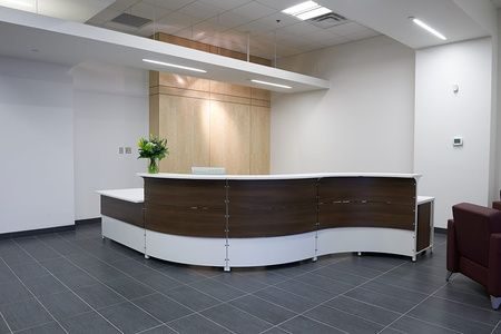 Artopex reception desk flows in this open space.