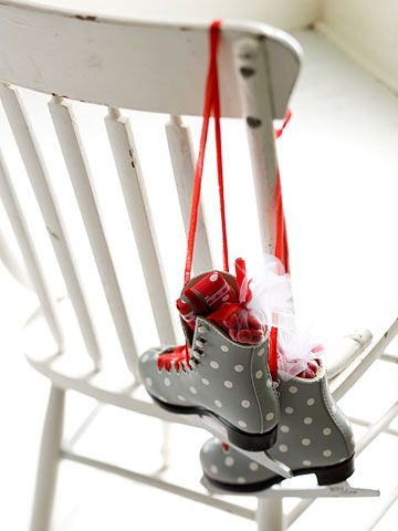 Christmas Ice Capades: Turn a pair of castoff skates into a charming Christmas decoration. Paint polka dots onto the boots of the skates and lace with lengths of red ribbon. Tuck small wrapped packages into the skates and hang from a banister or the back of a chair. Editor's Tip: To prevent injuries, make sure the skate blades are dull.