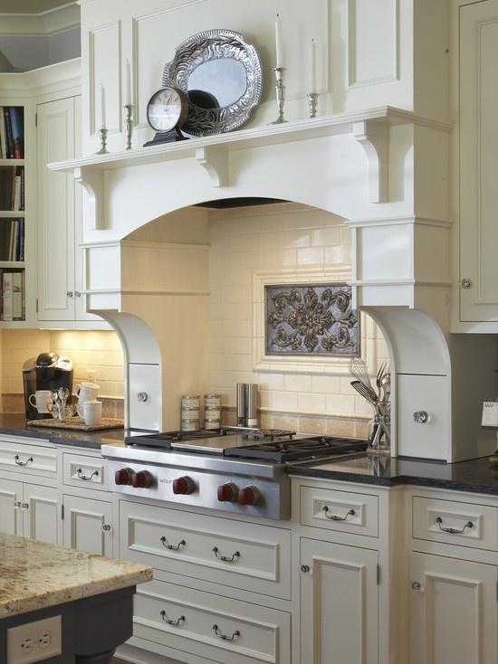 Modern Cape Cod.....soooo love this mantel shelf over stove  ~~~ Could be pull out spice drawers on each side of cook top