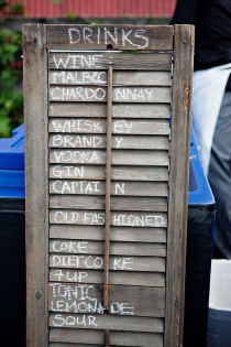 So simple and quirky - Drinks menu written on a old window shutter - repin from district 1 in The Wedding Games